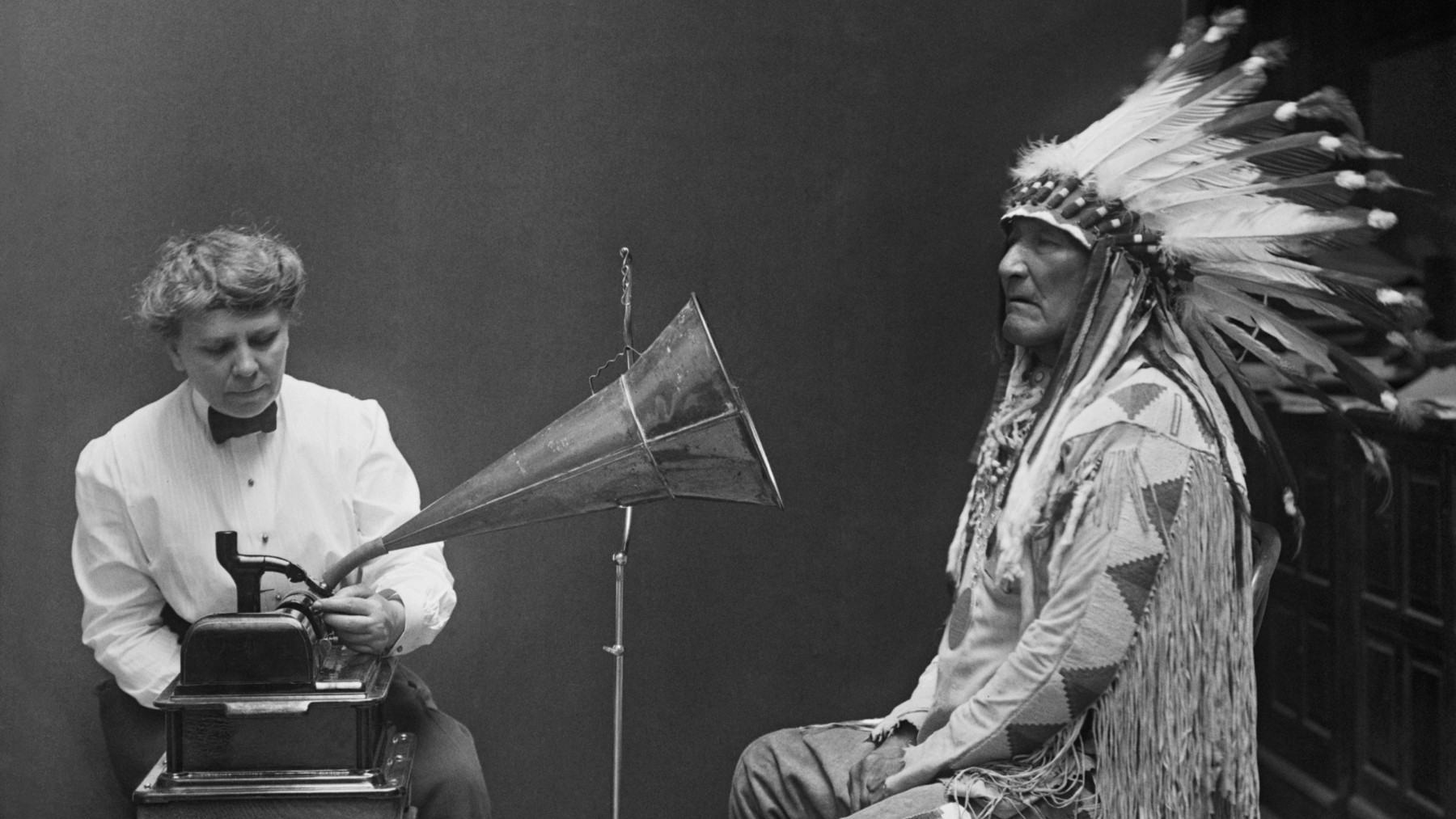 """Frances Densmore making a recording of Blackfoot chief Mountain Chief for the Bureau of American Ethnology. """"Blackfoot Chief,"""