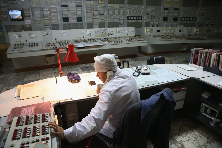 CHORNOBYL, UKRAINE - SEPTEMBER 29: A worker makes a phone call in the control room of reactor number two inside the former Chernobyl nuclear power plant on September 29, 2015 near Chornobyl, Ukraine. The Chernobyl plant is currently undergoing a decades-long decommissioning process of reactors one, two and three, which continued operation for years following the accident at reactor four. On April 26, 1986, technicians at Chernobyl conducting a test inadvertently caused reactor number four, which contained over 200 tons of uranium, to explode, flipping the 1,200 ton lid of the reactor into the air and sending plumes of highly radioactive particles and debris into the atmosphere in a deadly cloud that reached as far as western Europe. 32 people, many of them firemen sent to extinguish the blaze, died within days of the accident, and estimates vary from 4,000 to 200,000 deaths since then that can be attributed to illnesses resulting from Chernobyl's radioactive contamination. Today large portions of the inner and outer Chernobyl Exclusion Zone that together cover 2,600 square kilometers remain contaminated. A consortium of western companies is building a movable enclosure called the New Safe Confinement that will cover the reactor remains and its fragile sarcophagus in order to prevent further contamination. (Photo by Sean Gallup/Getty Images)