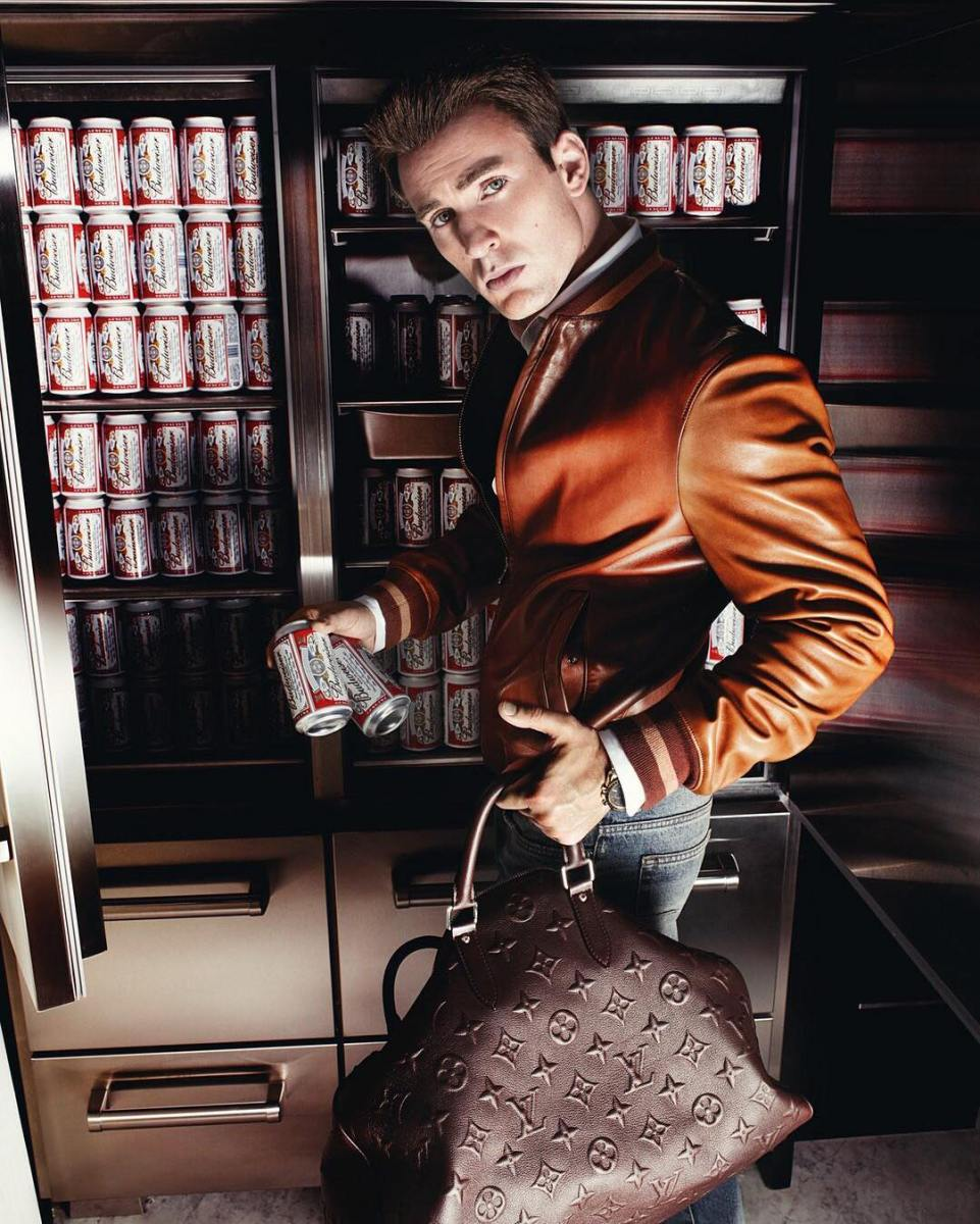 http://www.gq.com/gallery/chris-evans-mens-fall-fashion-preview#7  Chris Evans in Jacket, $898 and shirt, $60 by Tommy Hilfiger. Jeans, $630 by Dior Homme. Watch by Omega. Bag by Louis Vuitton.