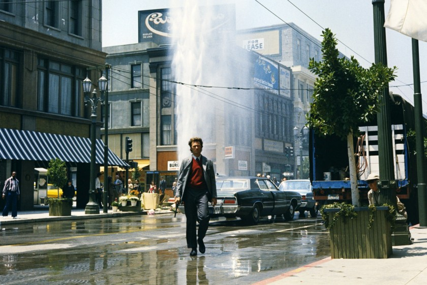Clint Eastwood, US actor, holding a .44 Magnum handgun, with a broken fire hydrant gushing water into the air behind him, in a publicity still from the film, 'Dirty Harry', USA, 1971. The 1971 thriller, directed by Don Siegel (1912-1991), starred Eastwood as 'Inspector Harry Callahan'. (Photo by Silver Screen Collection/Getty Images)