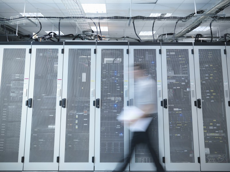 Blurred view of man in server room