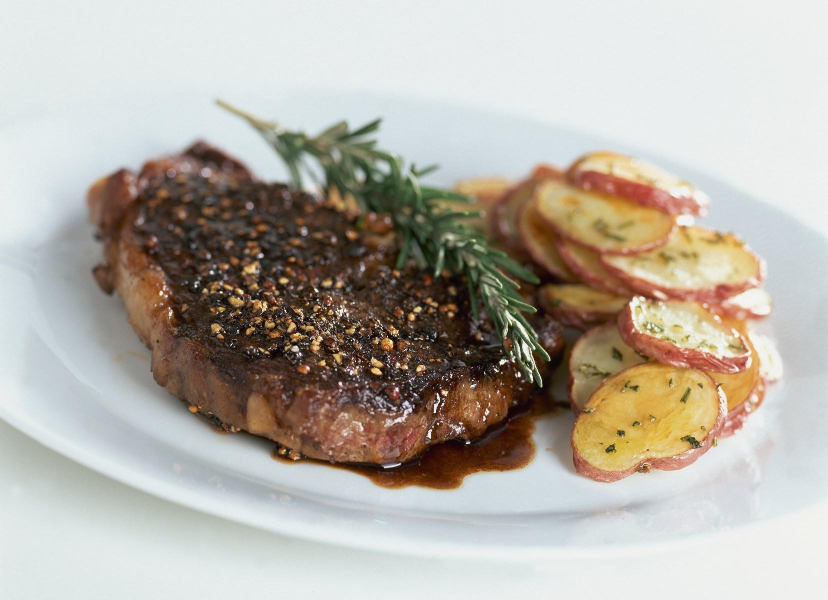 Rib-eye steak au poivre with balsamic reduction. Recipe by Lori W. Powell. (Photo byRomulo Yanes/Condé Nast via Getty Images)
