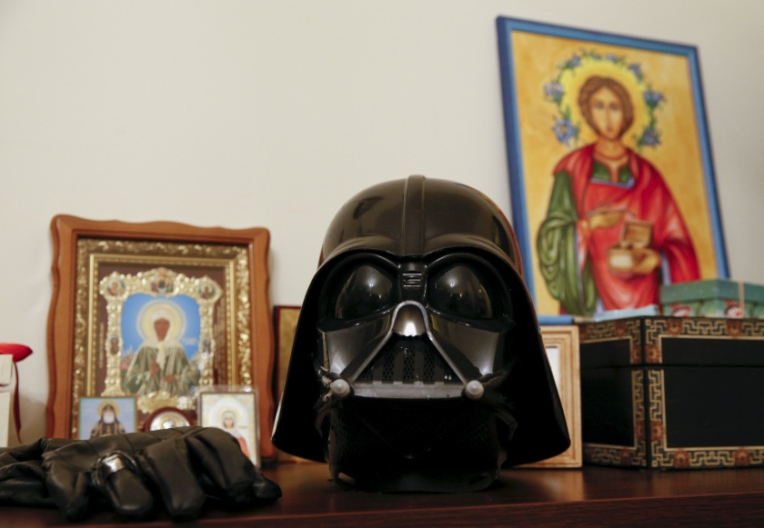 "Darth Mykolaiovych Vader's Darth Vader helmet sits on a shelf among icons at his apartments in Odessa, December 2, 2015. Darth Vader was bent on galactic domination, but his Ukrainian namesake enjoys more mundane pursuits: local politics, walking the family dog and a spot of embroidery. The Ukrainian citizen, who has changed his name to Darth Mykolaiovych Vader, ran for the post of local mayor in October, his political backers dressed as Stormtroopers. In his trademark black outfit, he is a regular sight around Odessa, a major port city on southern Ukraine's Black Sea coast. REUTERS/Valentyn Ogirenko PICTURE 22 OF 22 - SEARCH ""VALENTYN VADER"" FOR ALL IMAGES - RTX1Y83J"