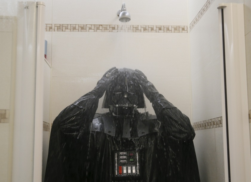 "Darth Mykolaiovych Vader, who is dressed as the 'Star Wars' character Darth Vader, poses for a picture as he takes a shower in a bathroom at his apartments in Odessa, Ukraine, December 4, 2015. Darth Vader was bent on galactic domination, but his Ukrainian namesake enjoys more mundane pursuits: local politics, walking the family dog and a spot of embroidery. The Ukrainian citizen, who has changed his name to Darth Mykolaiovych Vader, ran for the post of local mayor in October, his political backers dressed as Stormtroopers. In his trademark black outfit, he is a regular sight around Odessa, a major port city on southern Ukraine's Black Sea coast. REUTERS/Valentyn Ogirenko PICTURE 18 OF 22 - SEARCH ""VALENTYN VADER"" FOR ALL IMAGES - RTX1Y83X"