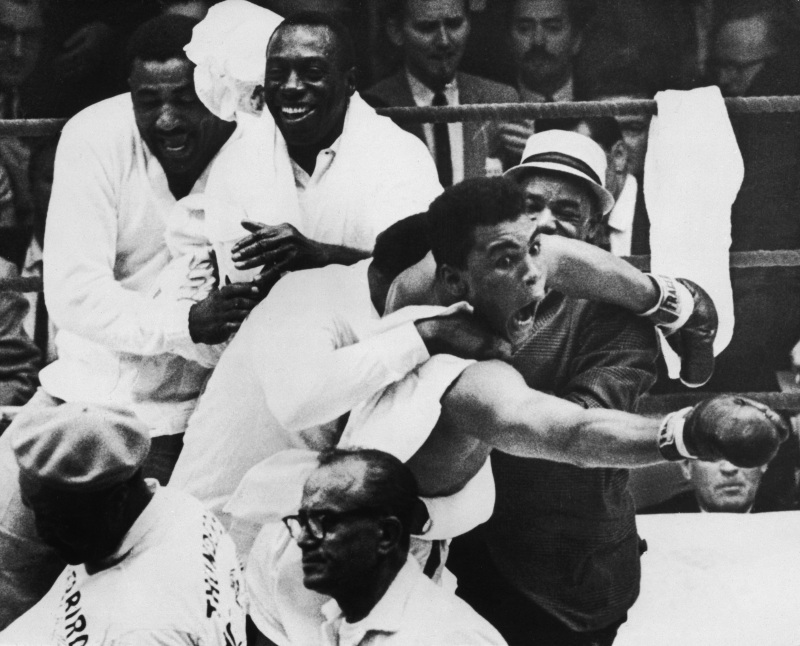 """27 Feb 1964: Cassius Clay (Muhammad Ali) flies around the ring after beating Sonny Liston in the seventh round of the World Heavyweight Title bout in Miami Beach, Florida, USA. It was during these scenes that Clay claimed, """"I am the Greatest"""" and """"I shook up the World"""". Mandatory Credit: Allsport Hulton/Archive"""