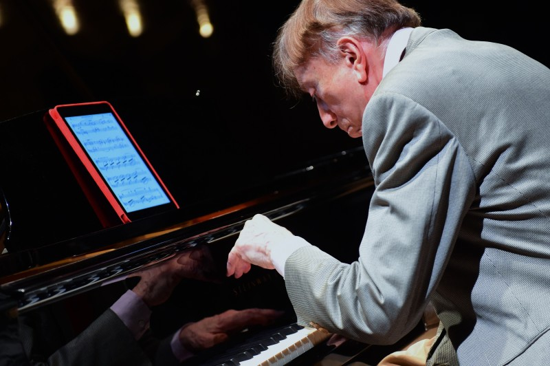 Hungarian pianist Tamas Vasary plays from a tablet with a sheet of a classical music in the concert hall of Budapest Music Center. (Attila Kisbenedek/AFP/Getty Images)