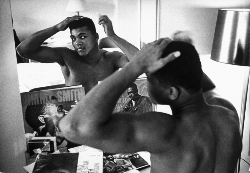 January 24, 1963 - Pittsburgh: Boxing heavyweight contender Cassius Clay (now Muhammad Ali) combing hair in mirror in hotel room before going outside on day of bout with opponent Charlie Powell. (Photo by Marvin Lichtner/The LIFE Images Collection/Getty Images)