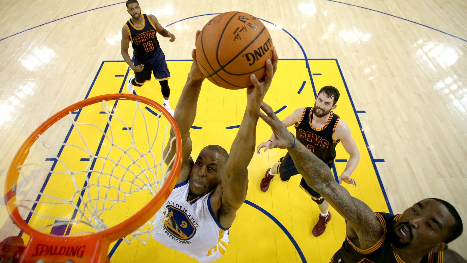 OAKLAND, CA - JUNE 02:  Andre Iguodala #9 of the Golden State Warriors goes up to dunk the ball against J.R. Smith #5 of the Cleveland Cavaliers in the first half in Game 1 of the 2016 NBA Finals at ORACLE Arena on June 2, 2016 in Oakland, California. NOTE TO USER: User expressly acknowledges and agrees that, by downloading and or using this photograph, User is consenting to the terms and conditions of the Getty Images License Agreement.  (Photo by Ezra Shaw/Getty Images)