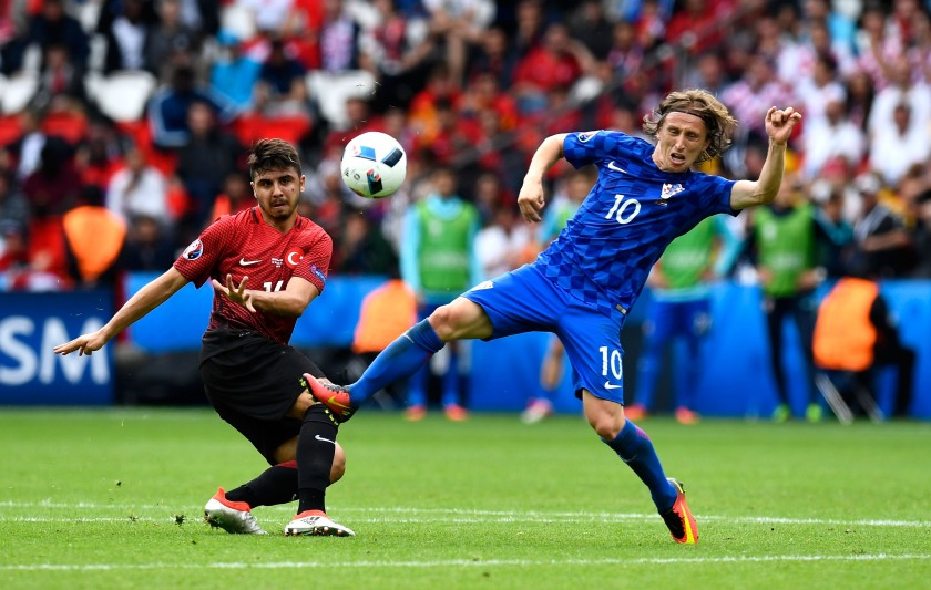 Ozan Tufan of Turkey and Luka Modric of Croatia compete for the ball during the UEFA EURO 2016 Group D match between Turkey and Croatia at Parc des Princes. (Mike Hewitt/Getty Images)