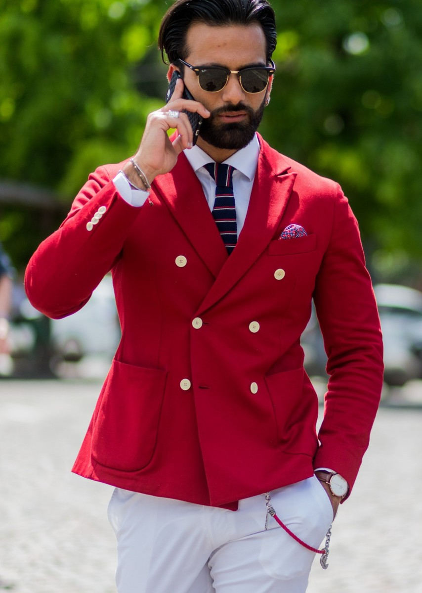 FLORENCE, ITALY - JUNE 15: Guests wearing a red and blue blazer and white pants during Pitti Uomo 90 on June 15, 2016, in Florence, Italy (Photo by Christian Vierig/Getty Images)