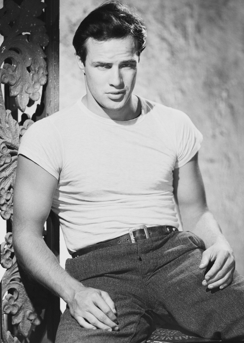 American actor Marlon Brando in character as Stanley Kowalski in the film 'A Streetcar Named Desire', directed by Elia Kazan, 1950.  (Photo via John Kobal Foundation/Getty Images)
