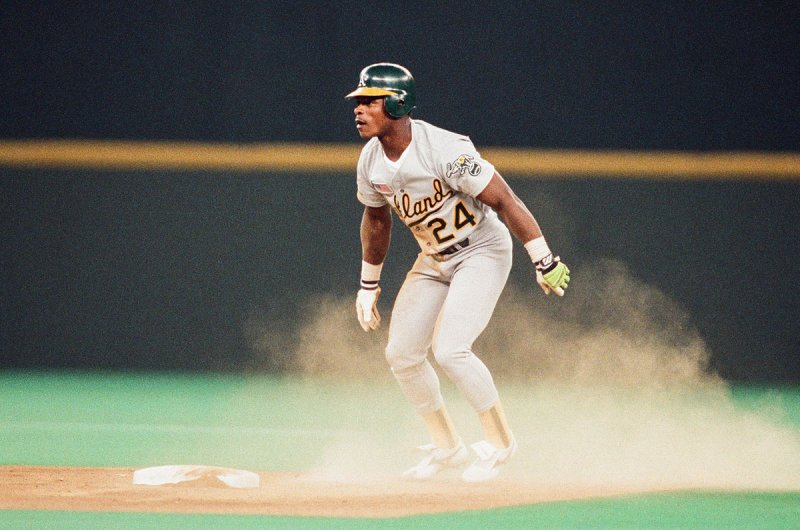 CINCINNATI, OH - 1990: Rickey Henderson of the Oakland Athletics runs the bases during the 1990 World Series against the Cincinnati Reds at Riverfront Stadium in Cincinnati, Ohio. (Photo by Sporting News via Getty Images)