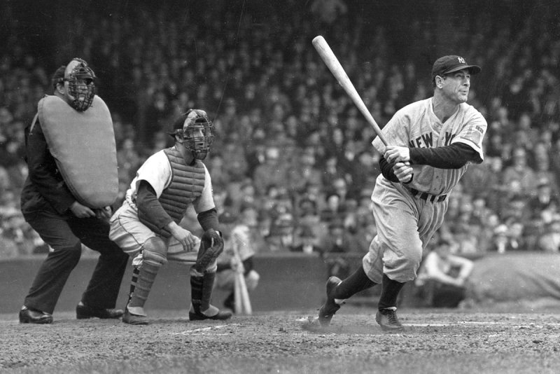 CHICAGO - 1938. Lou Gehrig whacks a double into left center in a game at Yankee Stadium in 1938. Luke Sewell is the catcher for the opponent White Sox. (Photo by Mark Rucker/Transcendental Graphics, Getty Images)
