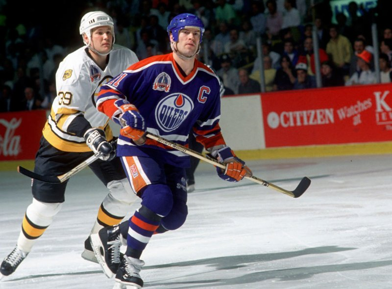 BOSTON, MA - MAY, 1990: Mark Messier #11 of the Edmonton Oilers skates on the ice against the Boston Bruins during the 1990 Stanley Cup Finals in May, 1990 at the Boston Garden in Boston, Massachusetts. (Photo by Bruce Bennett Studios/Getty Images)