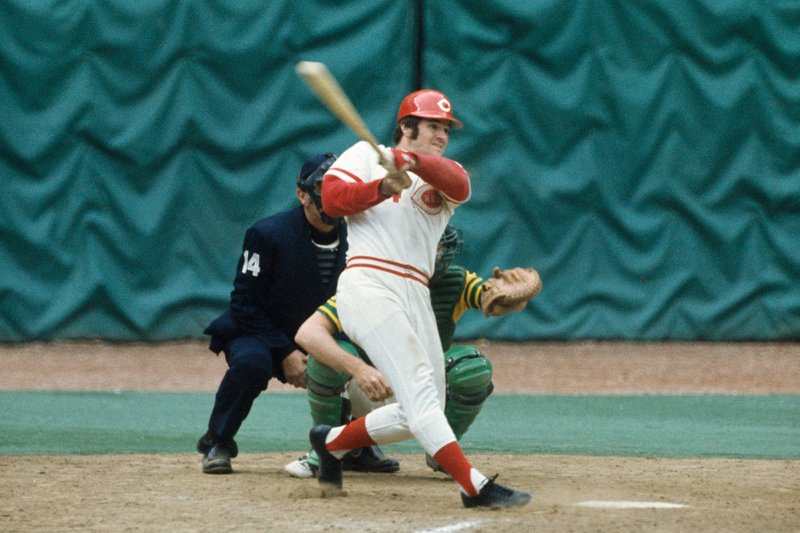 CINCINNATI - OCTOBER 1972: Pete Rose #14 of the Cincinnati Reds swings hard against the Oakland Athletics during the World Series at the Riverfront Stadium on October 1972 in Cincinnati, Ohio. (Photo by Focus on Sport/Getty Images)