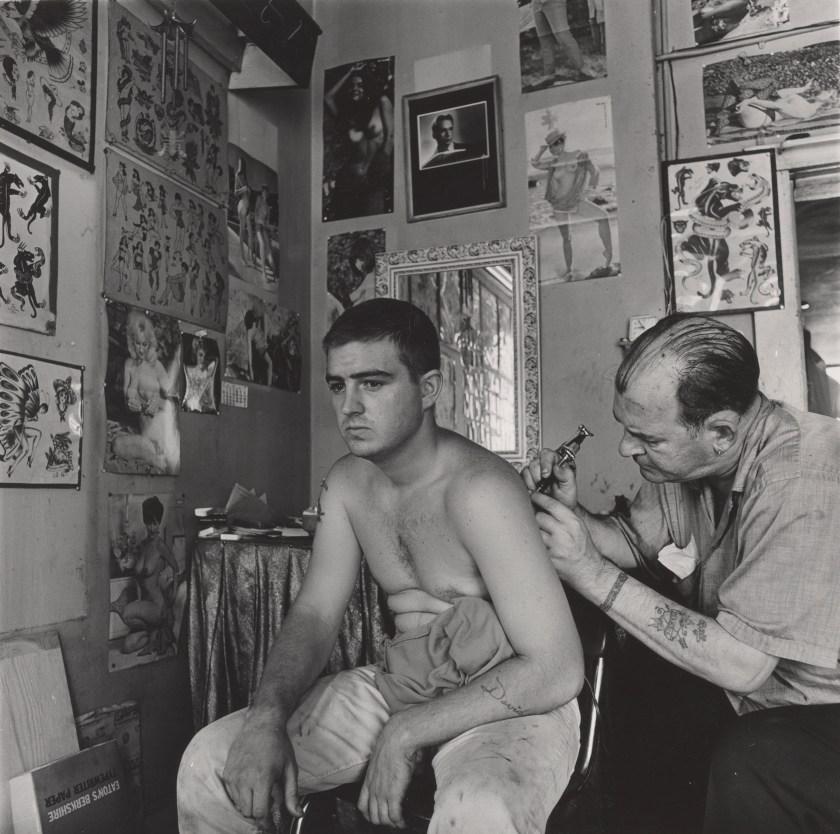 """""""Bill Sanders, Tattoo Artist, Houston, Texas,"""" 1968. Vintage gelatin silver print.(Danny Lyon, courtesy Edwynn Houk Gallery, New York)"""