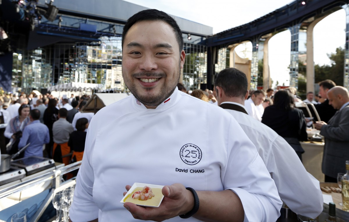 "David Chang poses during the festivities marking the 25th anniversary of French chef Alain Ducasse's restaurant ""Le Louis XV"", on November 17, 2012 in Monaco. (AFP PHOTO / VALERY HACHE)"