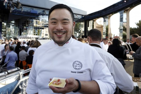 """David Chang poses during the festivities marking the 25th anniversary of French chef Alain Ducasse's restaurant """"Le Louis XV"""", on November 17, 2012 in Monaco. (AFP PHOTO / VALERY HACHE)"""