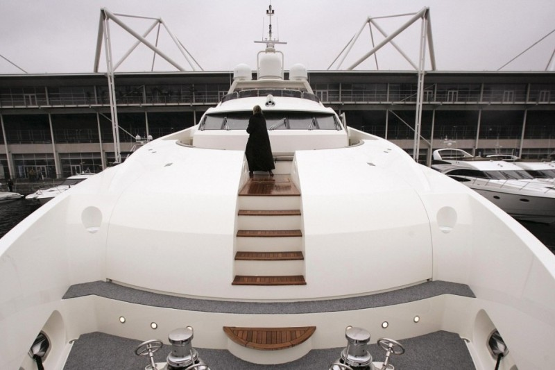 LONDON - JANUARY 05: A visitor walks around the deck of the largest British built 37 metre yacht, The Snapper, at the Boat Show on January 5, 2007 in London. The Boat show runs for ten days and has over 1000 boats on display. (Photo by Peter Macdiarmid/Getty Images)