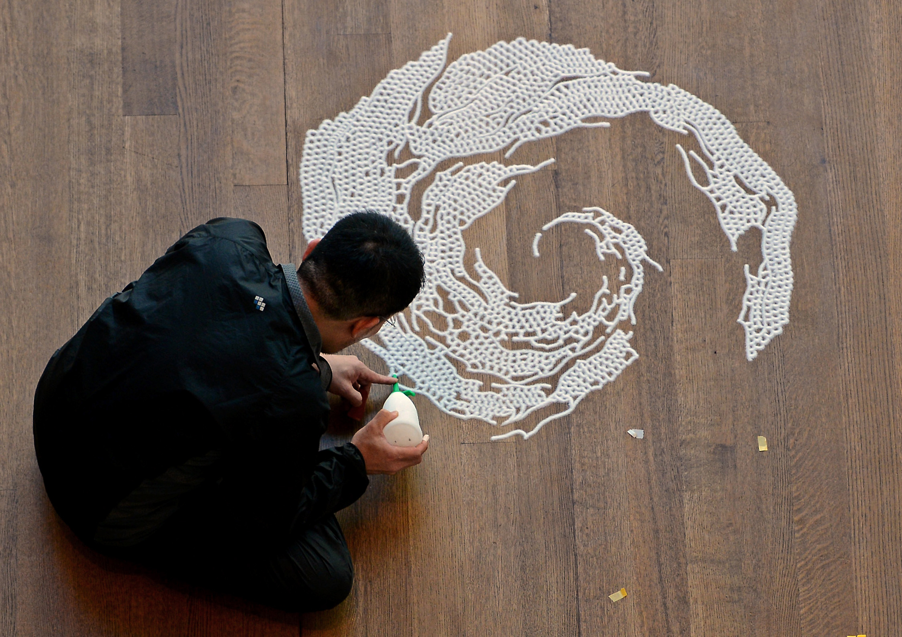 Artist Motoi Yamamoto works on his latest saltwork in the Robert Haywood Morrison Atrium at the Mint Museum Uptown in Charlotte, North Carolina, Monday, February 18, 2013. (Jeff Siner/Charlotte Observer/MCT via Getty Images)