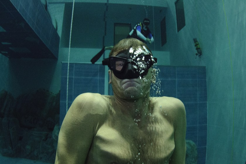 """Italian former legend of free diving, Umberto Pelizzari swims up during an apnea course at the """"Y-40 The Deep Joy"""" swimming pool on December 8, 2014 in Montegrotto Terme, northeastern Italy. The swimming pool is built over thermal sources bringing after cooling down a water at 32-34 degrees Celsius. Y-40, with its depth of 42mt, is officially included in the Guinness World Record as the deepest pool in the world for free and scuba diving. (Olivier Morin/AFP/Getty Images)"""