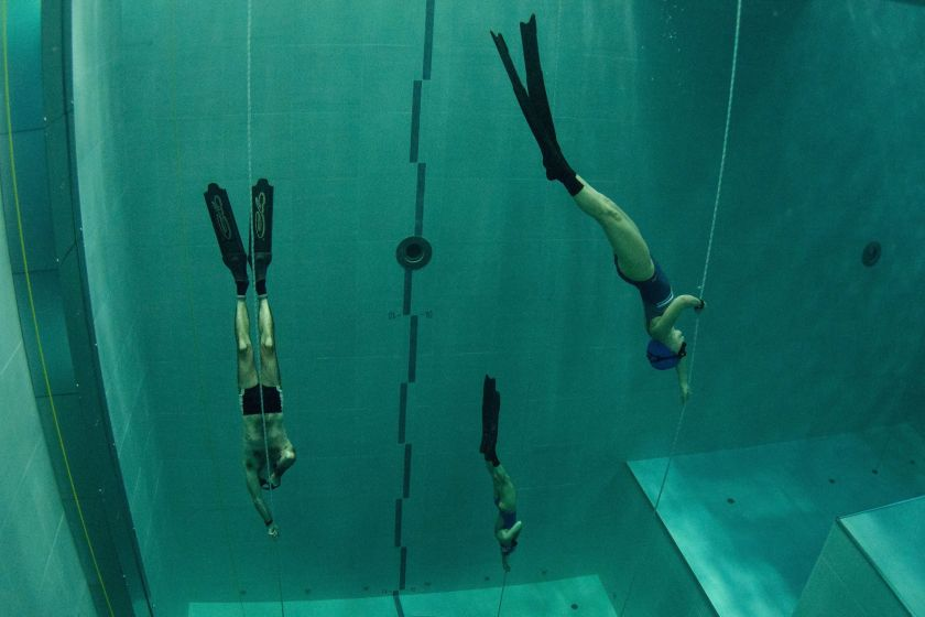 """Students swim during an apnea course by Italian free diver, Umberto Pelizzari, at the """"Y-40 The Deep Joy"""" swimming pool on December 8, 2014 in Montegrotto Terme, northeastern Italy. The swimming pool is built over thermal sources bringing after cooling down a water at 32-34 degrees Celsius. Y-40, with its depth of 42mt, is officially included in the Guinness World Record as the deepest pool in the world for free and scuba diving. (Olivier Morin/AFP/Getty Images)"""