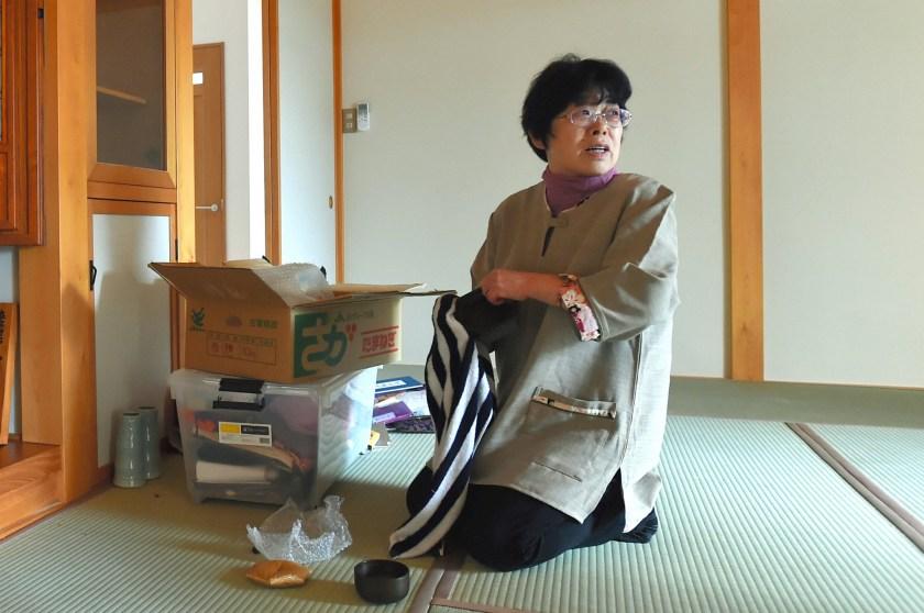 Kaneko Takahara, 66, sits on newly furbished tatami mat as she returns her home at former no-go zone of the crippled Fukushima Daiichi Nuclear Power Plant in Naraha. (The Asahi Shimbun via Getty Images)