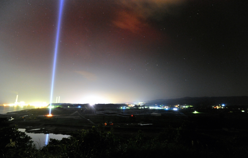 Blue tribute lights illuminate the sky as the evacuation order is to be lifted on September 4, 2015 in Naraha, Japan. (The Asahi Shimbun via Getty Images)