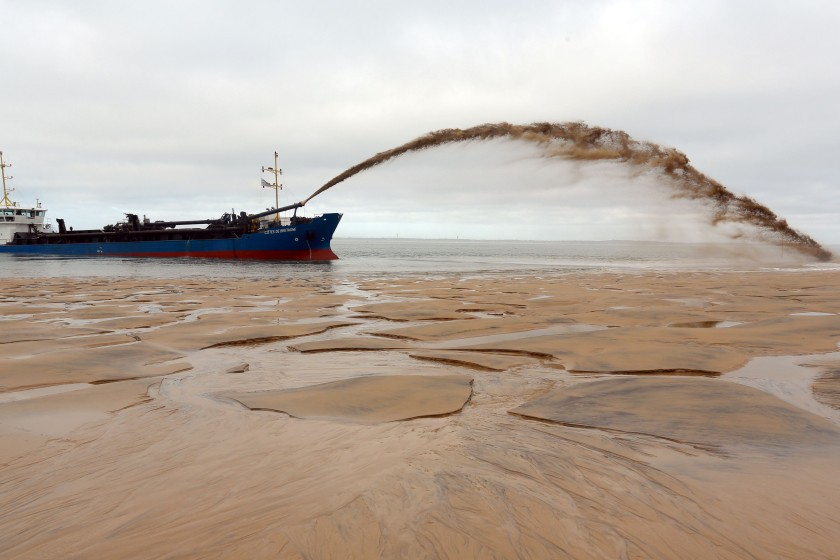 "The dredger ""Cotes de Bretagne"" shoots sand onto a beach of Pyla-sur-Mer in La Teste-de-Buch in Arcachon Bay. The boat, from Brittany, pumps sand from offshore sand bars before shooting it back onto beaches using a technique known as ""the rainbow"", in an effort to fight against erosion. (Nicolas Tucat/AFP/Getty Images)"
