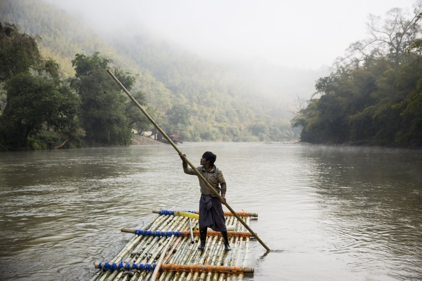 A worker controls the raft of a rig at a sand dredging site on a river near Kengtung, Shan State, Myanmar, on Thursday, Feb. 18, 2016. The recently-elected National League for Democracy has been vague about its plans for the country. Its economic platform pledged to do things such as expand the tax base and increase foreign investment, without saying how. (Taylor Weidman/Bloomberg via Getty Images)