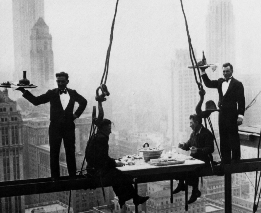 (GERMANY OUT) NEW YORK: WALDORF-ASTORIA. Construction workers having lunch on a suspended I-beam during the construction of the present day Waldorf-Astoria Hotel on Park Avenue at 49th Street, New York. Photograph, c1930. (Photo by ullstein bild/ullstein bild via Getty Images)