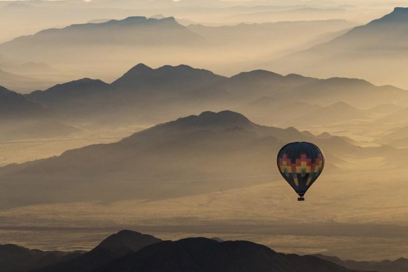 Hot air ballon over the Namib desert (Jonathan & Angela Scott/AWL Images/Creative RM/Getty Images)