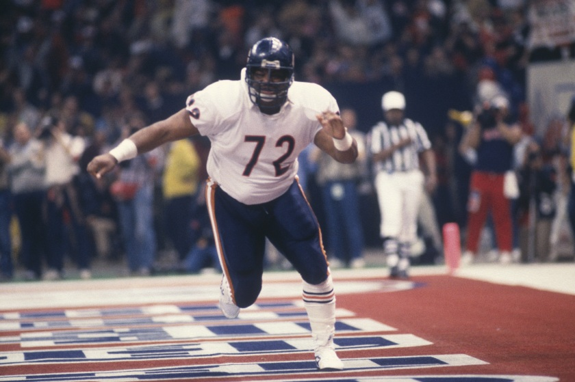 "Defensive Lineman William ""The Refrigerator"" Perry #72 of the Chicago Bears runs in the end zone during Super Bowl XX against the New England Patriots at the Superdome on January 26, 1986 in New Orleans, Louisiana. The Bears defeated the Patriots 46-10. (Focus on Sport/Getty Images)"