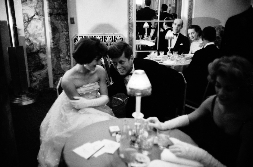 Senator (and future US President) Jack Kennedy (1917 - 1963) lending an ear to his wife Jacqueline (1929 - 1994) as they sit at table at the Waldorf Astoria Hotel, New York, New York, November 22, 1956. They were there during cocktail hour before dining at a society gala sponsored by the wife of the US ambassador to Cuba. (Photo by Alfred Eisenstaedt/The LIFE Picture Collection/Getty Images)