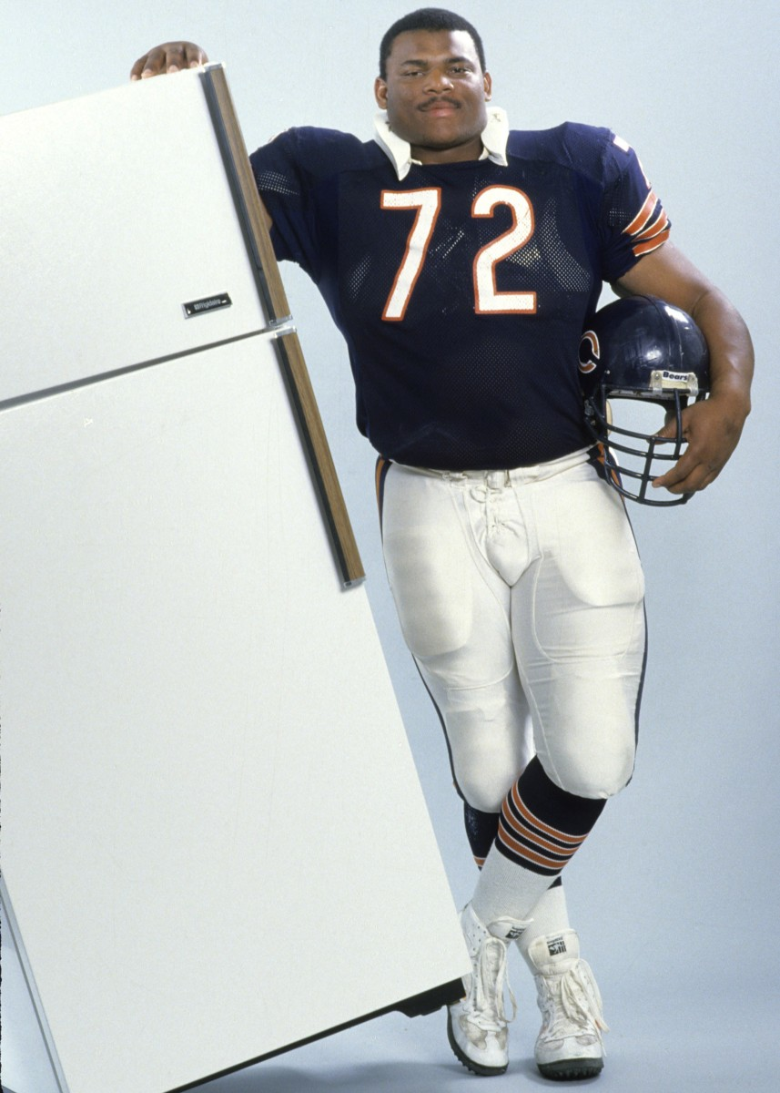 "William Perry, Chicago Bears defensive tackle aka, William "" Refrigerator"" Perry  poses with a refrigerator. (Photo by Bill Smith/Getty Images)"