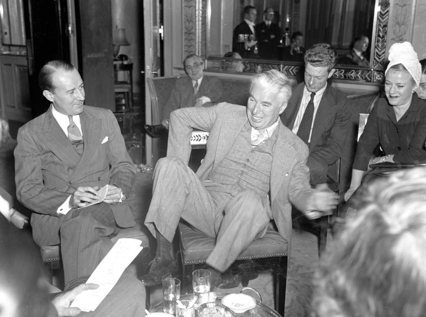 UNITED STATES - OCTOBER 13: Charlie Chaplin being interviewed by reporters at the Waldorf Astoria. (Photo by Walter Kelleher/NY Daily News Archive via Getty Images)