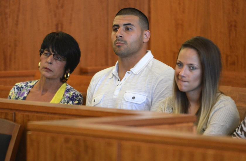 Aaron Hernandez' mother Terri Hernandez, left, brother D.J. Hernandez, center, and an unidentified woman listen to proceedings during a hearing in Fall River superior court Monday July 7, 2014, in Fall River. Mass. The Judge agreed that Hernandez could be moved to a jail closer to Boston while he awaits his trial for the murder of Odin Lloyd. (AP Photo/The Boston Globe, Josh Reynolds, Pool)