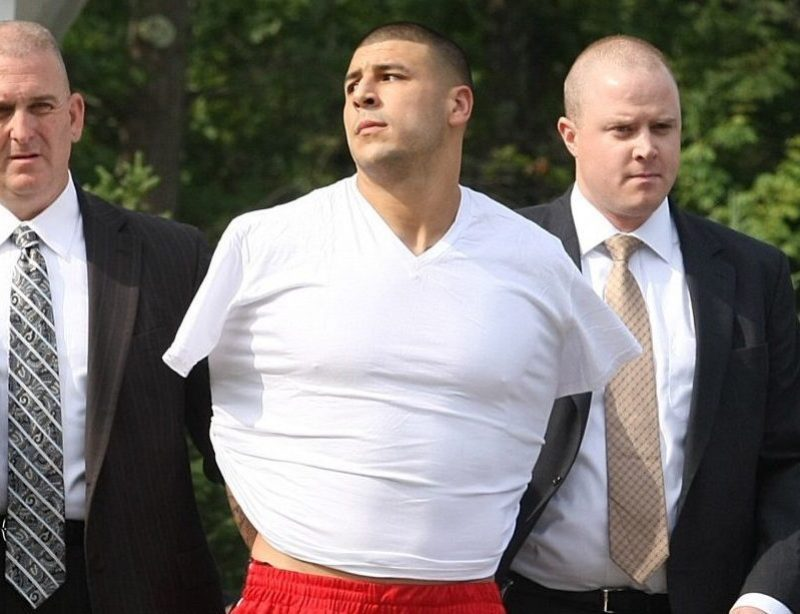 NORTH ATTLEBOROUGH, MA - JUNE 26: New England Patriots tight end Aaron Hernandez was arrested and led out of his home in handcuffs, shortly before 9 a.m. It is not immediately known what charges he is facing, but he has been under investigation in connection with the murder of Odin Lloyd. (Photo by George Rizer for The Boston Globe via Getty Images)