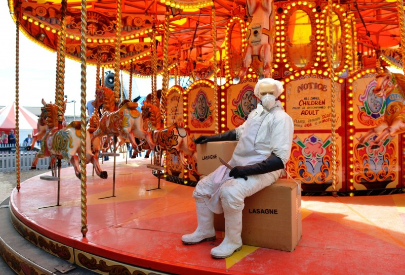 WESTON-SUPER-MARE, ENGLAND - AUGUST 28: A sculpture depicts a 'horse meat' butcher on a carousel as Banksy's Dismaland Bemusement Park opens to the public, on August 28, 2015 in Weston-Super-Mare, England. Graffiti artist Banksy has opened the subversive, pop-up theme park styled exhibition at the derelict seafront Tropicana lido, featuring the work of 50 artists. The 'Bemusement Park' combines dark humour and 'entry-level anarchism' and will open for just five weeks. (Photo by Jim Dyson/Getty Images)