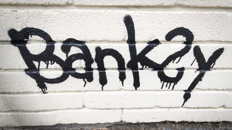 The name Banksy is written as part of a mural which was painted on the side of one of the classrooms at Bridge Farm Primary in Bristol during half-term on June 7, 2016, in Bristol, England. The 14-foot piece was said to be a thank you by the elusive artist after the school recently named a house after him. (Matt Cardy/Getty Images)