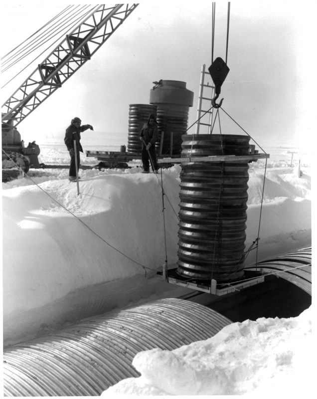 A crane lowers a hatch into a lateral trench of the permanent camp at Camp Century in Greenland. (Photo by Pictorial Parade/Archive Photos/Getty Images)