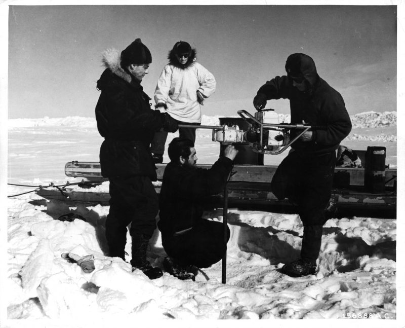 Scientists drill a hole in the huge cake of ice during construction of the Arctic camp site in Greenland. (Photo by Pictorial Parade/Archive Photos/Getty Images)