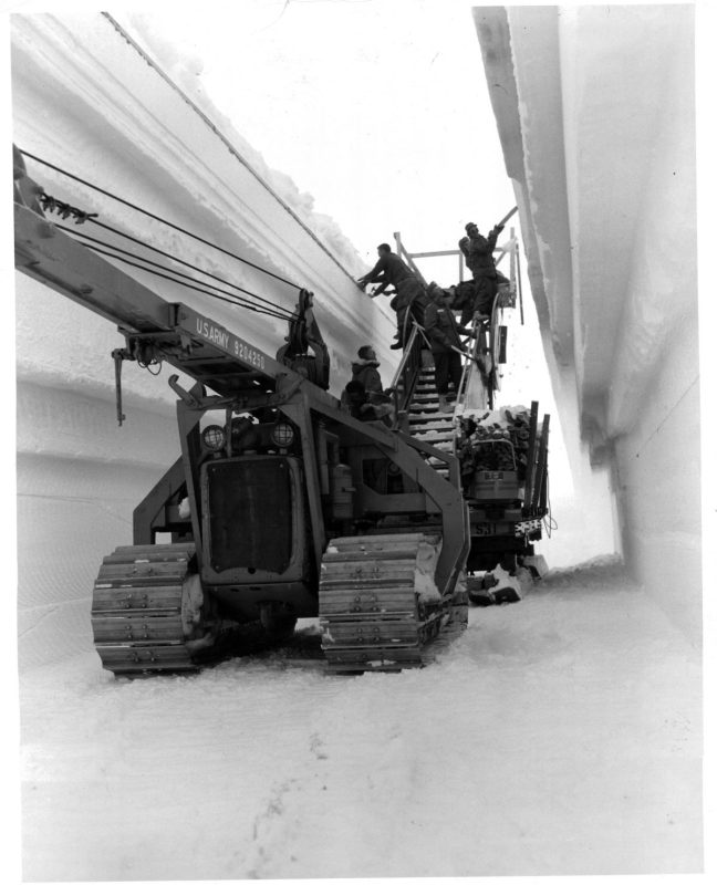 Men place arch supports in the tunnel to main trench of the permanent camp at Century Camp, Greenland. (Photo by Pictorial Parade/Archive Photos/Getty Images)