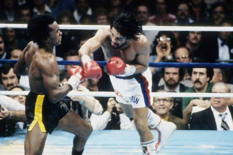 NEW ORLEANS - NOVEMBER 25,1980: Roberto Duran (R) leaps to land the punch against Sugar Ray Leonard during the fight at the Superdome in New Orleans, Louisiana. Sugar Ray Leonard won the WBC welterweight title by a TKO 8. (Photo by: The Ring Magazine/Getty Images)
