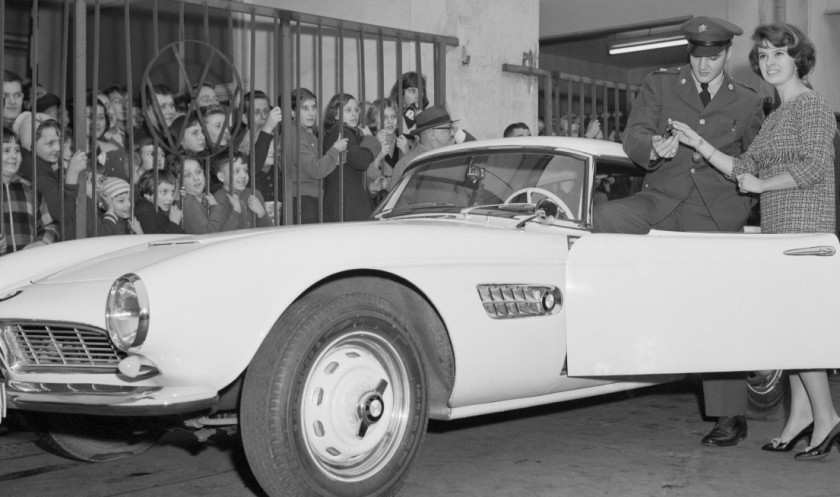 Elvis Presley is seen here accepting the keys for his BMW 507 sports car in 1958.(Getty)