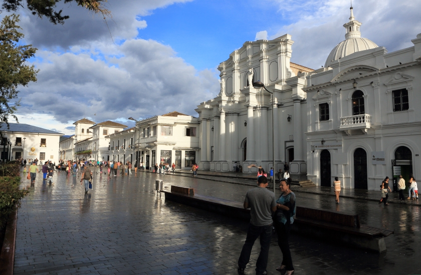 Pedestrians walk past Nuestra Senora Basilica in Parque Caldes. (Getty Images)