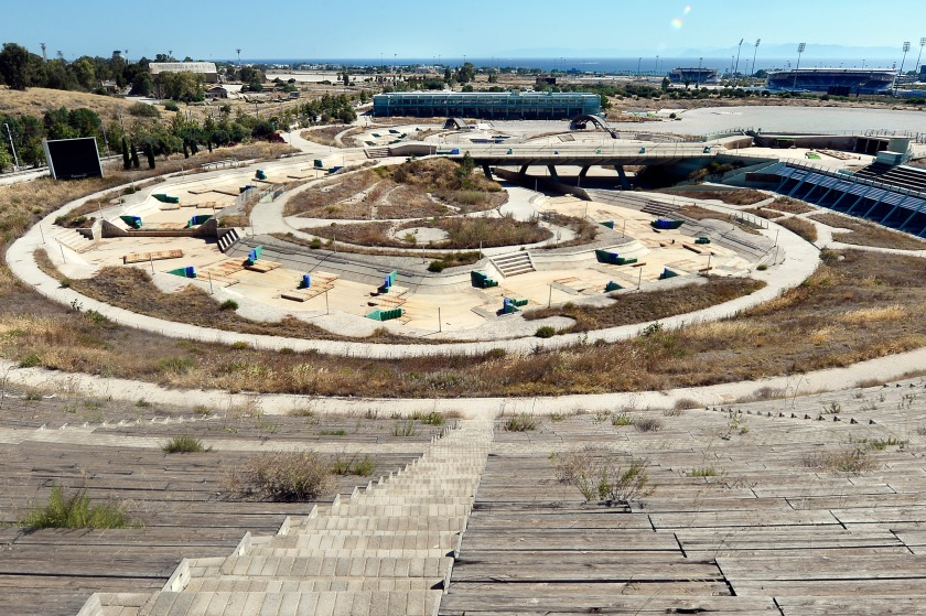 """ATHENS, GREECE - JULY 31: General view of the Olympic Canoe/Kayak Slalom Center at the Helliniko Olympic complex in Athens, Greece on July 31, 2014. Ten years ago the XXVIII Olympiad was held in Athens from the 13th - 29th August with the motto """"Welcome Home"""". The cost of hosting the games was estimated to be approx 9 billion euros with the majority of sporting venues built specifically for the games. Due to Greece's economic frailties post Olympic Games there has been no further investment and the majority of the newly constructed stadiums now lie abandoned. (Photo by Milos Bicanski/Getty Images)"""