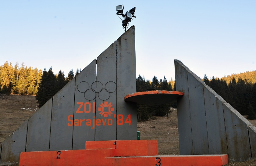 TO GO WITH STORY BY RUSMIR SMAJILHODZIC - A picture taken on February 5, 2014 shows the partialy rebuilt winners podium of Sarajevo's abandoned ski jumping venue at Mt. Igman near Sarajevo. Built and used as an Olympic venue during Sarajevo's 1984 Winter Olympic Games, the ramps were heavily damaged during Bosnia's 1992-95 war. They were never rebuilt and it's large concrete structure remains standing as a memento of past. AFP PHOTO ELVIS BARUKCIC / AFP / ELVIS BARUKCIC (Photo credit should read ELVIS BARUKCIC/AFP/Getty Images)
