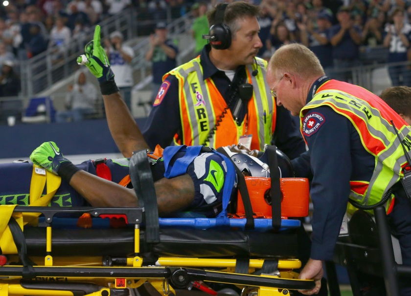 Ricardo Lockette #83 of the Seattle Seahawks waves to fans while being carted off the field in the second quarter at AT&T Stadium on November 1, 2015 in Arlington, Texas. (Photo by Tom Pennington/Getty Images)