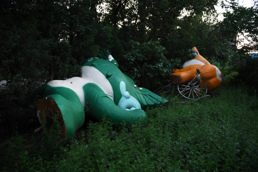 This photo taken on July 26, 2016 shows Nini (L) and Yingying, two of the five mascots for the 2008 Beijing Olympic Games, lying among trees behind an abandoned, never-completed mall in Beijing. Photographed weeks before the 2016 Olympics open in Rio, the fallen mascots are a reminder of the high costs of hosting the event. Their derelict state reflects the challenges that China has faced in finding new uses for its Olympic investments, with many venues falling into disrepair and some construction projects left incomplete. / AFP / GREG BAKER / TO GO WITH STORY Oly-2016-Rio-China-mascots-offbeat (Photo credit should read GREG BAKER/AFP/Getty Images)